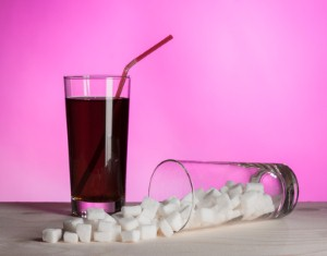 A new study has shown that drinks with a high sugar content can be harmful even for people who are not overweight. Image Credit: DundStock