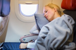 Falling asleep during flight take-off and landing could seriously damage a persons hearing, according to new research. Image: kasto80 via iStock
