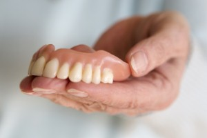 People with false teeth may be more likely to suffer repeated bone breaks and fractures, according to a new study. Image: wernerimages via iStock