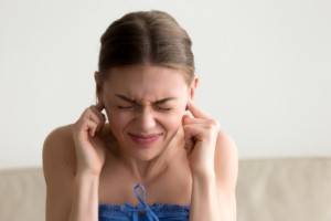Minor hearing loss among young people may be paving the way for a higher risk of dementia in later life, according to a new study.