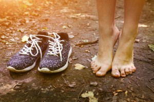 Going barefoot in childhood and adolescence may help people to develop a stronger bone structure in their feet, new research suggests. Image credit: Ulianna via iStock